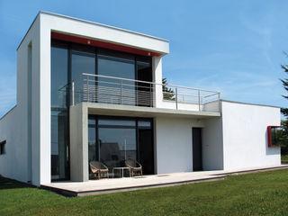 ATELIER D'ARCHITECTURE ET D'URBANISME MARTIAL Modern Houses