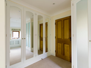 Wardrobes painted some with Matelux glass Tim Wood Limited Modern dressing room
