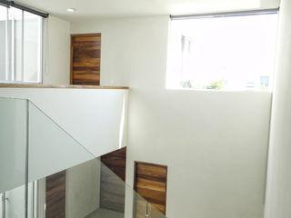 Abraham Cota Paredes Arquitecto Pasillos, vestíbulos y escaleras de estilo moderno