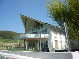 Brun & Mahler GmbH Дома в стиле кантри