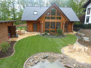 Neugestaltung eines Wohlfühlgartens an einem Blockhaus Gärten für Auge und Seele