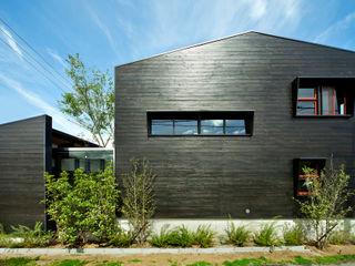 石井智子/美建設計事務所 Casas de estilo asiático