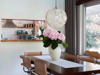 HANDE KOKSAL INTERIORS Industrial style dining room