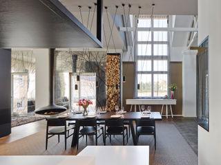 Loft ESN Ippolito Fleitz Group – Identity Architects Comedores de estilo moderno
