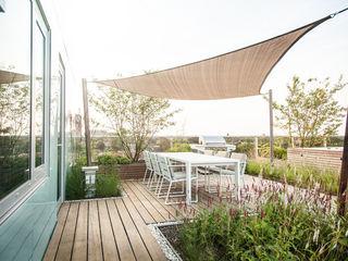 Studio REDD exclusieve tuinen Balcones y terrazas modernos: Ideas, imágenes y decoración