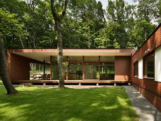 atelier137 ARCHITECTURAL DESIGN OFFICE Nowoczesne domy Cegły Brązowy