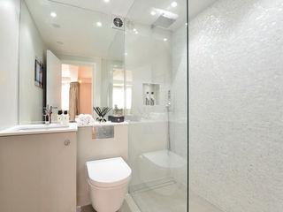 Apartment decorated in Black lip herringbone pattern and natural freshwater Mother of Pearl mosaics ShellShock Designs Modern bathroom