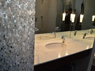Seamless freshwater pure white mother of pearl used in the bathroom and kitchen of architect Timothy Crum's home. ShellShock Designs Modern bathroom