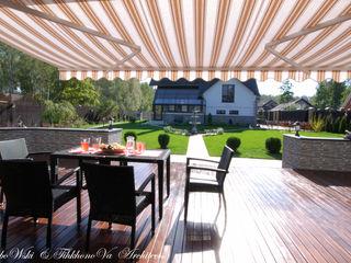 D&T Architects Casas de estilo clásico