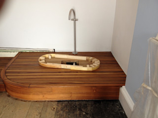 Copper bateau bath with riva teak platform design and installation in Tenby Pembroke Bathrooms