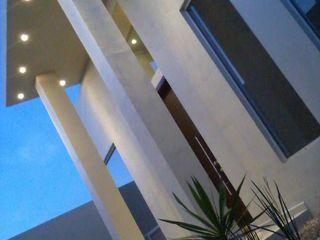 Casa Minimalista Guiza Construcciones Espacios comerciales de estilo minimalista