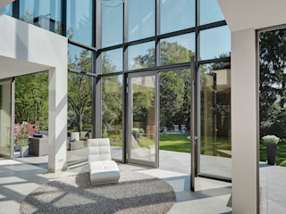 28 Grad Architektur GmbH Modern style conservatory
