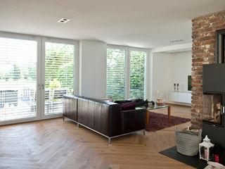 Umbau Einfamilienhaus in Düsseldorf Architekturbüro J. + J. Viethen Klassische Wohnzimmer