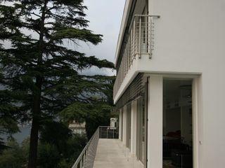 Villa Privata – Blevio Lago di Como Archiluc's - Studio di Architettura Stefano Lucini Architetto Case moderne