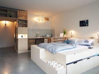 Main space homify Dormitorios eclécticos