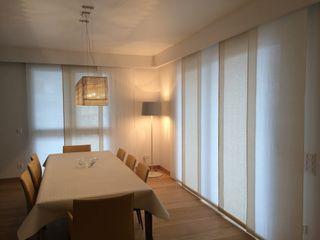 Attico privato Archiluc's - Studio di Architettura Stefano Lucini Architetto Sala da pranzo moderna