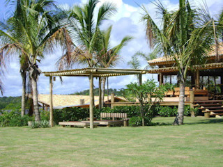 Línea Paisagismo.Claudia Muñoz Tropical style gardens