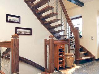 STREGER Massivholztreppen GmbH Rustic style corridor, hallway & stairs