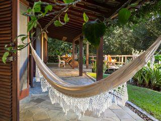 Lucia Manzano Rustic style balcony, porch & terrace
