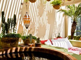 CARMELLO ARQUITETURA Eclectic style garden