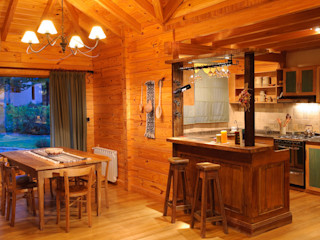 Patagonia Log Homes - Arquitectos - Neuquén Country style dining room Wood Brown
