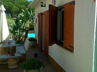 Porticones de madera FUSTERS CÓRDOBA Casas de estilo rústico