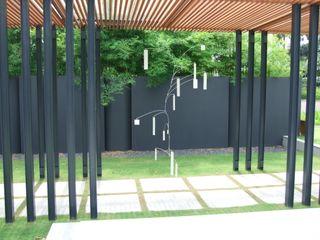 Tinderbox Landscape Studio Estadios de estilo tropical