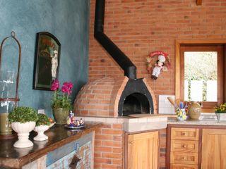Liliana Zenaro Interiores Cucina in stile rustico