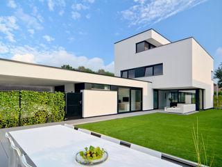 CKX architecten Casas de estilo moderno