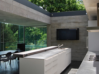 Kitchen with sliding rooflight to create open-air court Eldridge London Kitchen