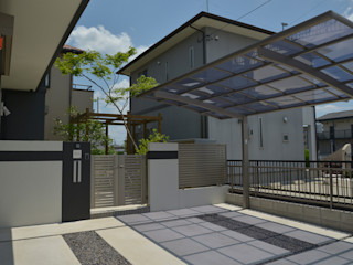 T's Garden Square Co.,Ltd. Casas de estilo ecléctico