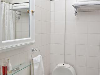 GUTMAN+LEHRER ARQUITECTAS 現代浴室設計點子、靈感&圖片