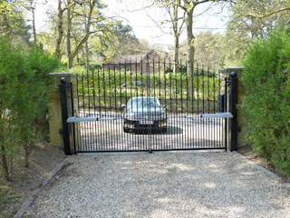 Metal Electric Gates with above ground motors Portcullis Electric Gates Classic style garden