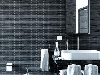 Progetto di ristrutturazione di casa privata GHINELLI ARCHITETTURA Bagno moderno Ceramica Nero