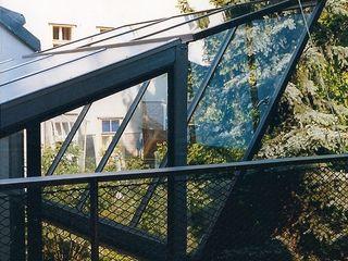 glashaus - wintergarten allmermacke Industrialer Wintergarten Glas