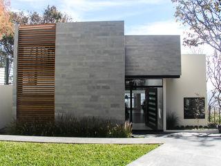 aaestudio Casas modernas: Ideas, diseños y decoración Piedra Gris
