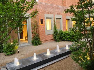 Casa en Mailyng JUNOR ARQUITECTOS Jardines modernos: Ideas, imágenes y decoración