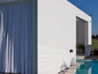 VISMARACORSI ARQUITECTOS Modern houses