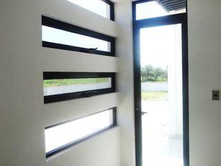 CONSTRUCTORA ARQOCE Modern style bedroom