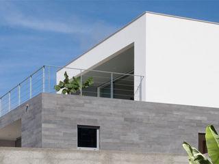 Mayer & Selders Arquitectura Будинки Камінь Сірий