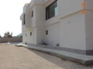 Vivienda unifamiliar estudio MG arquitectura y urbanismo Casas de estilo moderno Blanco