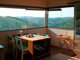 Cabana Arquitetos Comedores de estilo rústico Madera