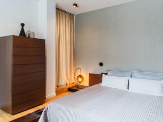 KJUBiK Innenarchitektur Спальня в стиле модерн