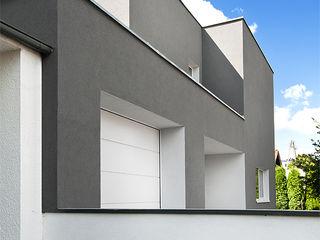 PL+sp. z o.o. Modern houses Grey
