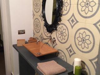Cementine - idee bagno Romano pavimenti Bagno eclettico