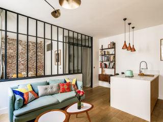 SALON/ PROJET LAMARTINE, Transition Interior Design Architectes: Margaux Meza et Carla Lopez Photos: Meero Transition Interior Design Fer / Acier