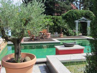 Natur & Heim GmbH Jardines de estilo mediterráneo Granito