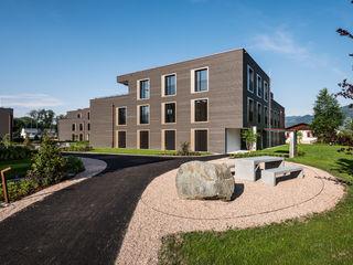Überbauung Fuchsloch Giesser Architektur + Planung Moderne Häuser Holz Bernstein/Gold