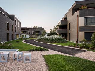 Überbauung Fuchsloch Giesser Architektur + Planung Moderner Garten Holz Bernstein/Gold