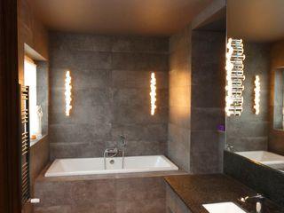livinghome wnętrza Katarzyna Sybilska Ванная комната в стиле модерн Камень Коричневый